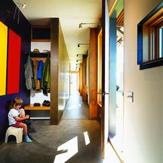 hay shed turned into family home...i love the hallway with the big windows