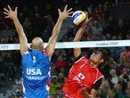 Phil Dalhausser of the United States attempts to block Kentaro Asahi of Japan
