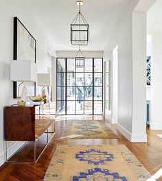 Two rugs are better than one in this stunning entryway designed by @jenkinsinteriors : @nathanschroderphoto