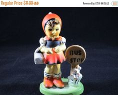 This is a Pixie Girl figurine standing at the Bus Stop. Figurine is 4 1/2 inches tall. it is in excellent condition. It would make an excellent addition to your figurine collection, or as an ornament on your Christmas Tree. Oranges, yellows and blue. Made in Hong Kong.          To view other Christmas items in my Shop click on the following Link:  https://www.etsy.com/shop/DigginThruTheAttic?section_id=15953125&ref=shopsection_leftnav_3 | Shop this product here…