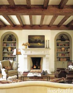family room  living room  cream walls  wood ceiling beams  warm room
