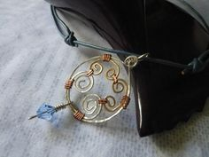 Mandala. Hammered alpaca brass and copper wire by MergruenDesigns, $18.00
