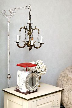 I found a vintage chandelier at my favorite junk shop then found an antique floor lamp at the same shop. The two junk treasures are perfect together. Junk Love.