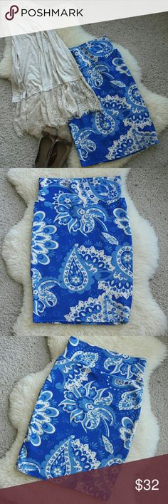 """Lularoe Royal Blue Paisley Cassie Pencil Skirt I love this Cassie! But I've owned it for a year & only worn it once, favoring other prints instead. Royal blue, cornflower blue, dark cream mixed in a large-scale flowery paisley print, including daisies & tulips. Standard stretchy Cassie/Amelia fabric, wide waistband, flattering curved cut. 30"""" waist, 35"""" hips, 24"""" long, not accounting for stretch. Smoke-free home & perfect condition, shown w/items from my closet, bundle for a discount…"""