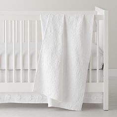 All white bedding...with grey bedskirt from serena.   The Land of Nod | Baby Bedding: All White Crib Bedding in Crib Bedding