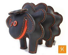 "Rubber Sheep by Ricardo Geldres Piumatti & Kareen Nishimura Doy: Made of reclaimed rubber inner tube in Peru. Also available in blue, green, orange and yellow. 9 x 6.5"", $49"