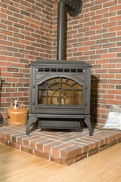 Wood burning stove, but with stacked stoneGranddaddy's Wood burning stove turned fireplace