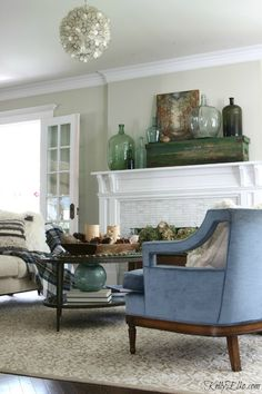 Fall living room - love the glass demijohn collection on the mantel eclecticallyvintage.com