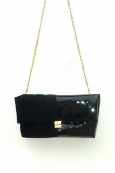 Black suede and patent leather folded clutch by TATYZ