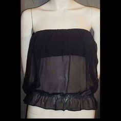 Gucci Black Silk Chiffon & Velvet Bustier Top 38IT This sexy top is done in black silk chiffon that is open on the sides to reveal the wide black velvet band at the bust that acts as a built-in bra. Black leather belts with gunmetal buckles run across the sides at the waist over hidden snaps allowing the chiffon to blouse slightly.  Body: 100% Silk Chiffon Bustier: 100% Silk Velvet Bustier Lining: 100% Silk Satin Trim: 100% Leather  38 Italian (4 to 6 US) - Runs small at the bust and may be…