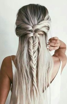 Grey fishtail plait woven in behind half up half down hair style