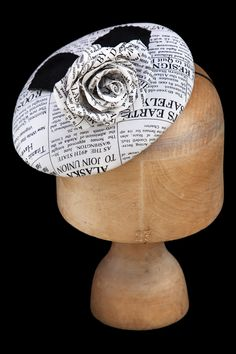 (Louise Pocock Millinery) loving the newspaper fabric