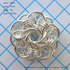 Vortex Medallion is the name of our version of this beautiful and clever mix of Parallel Chain and a Mobius Rose.