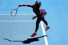 Serena Williams of the United States serves in her Quarterfinal match against Sloane Stephens of the United States during day ten of the 2013 Australian Open at Melbourne Park on January 23, 2013 in Melbourne, Australia.