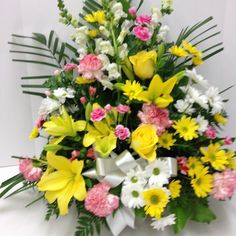 #tribute #lilies #roses #daisies #snapdragons #carnations