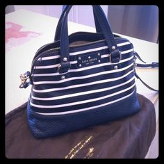 Kate Spade Grove Court Stripe SIZE 9''h x 10.5''w x 4.9''d drop length: 4'' handheld, 10.5-12'' adjustable strap MATERIAL large mariner stripe printed on lacquered twill with cowhide pebble trim DETAILS elbow hold with shoulder strap and zip top closure interior zip and double slide pockets. Comes with dust bag kate spade Bags