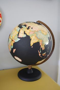 Globe with the oceans painted with chalkboard paint for messages or notations