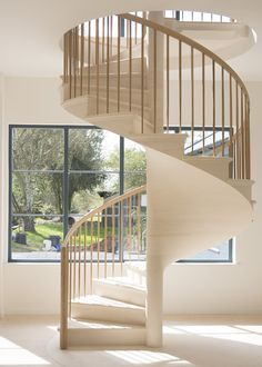 The UK's first self supporting limestone staircase, with a wooden bannister designed by one of deVOL's most experienced carpenters.