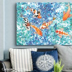 """Graceful koi fish are the stars of this versatile-yet-colorful assortment of art. """"Koi"""" canvas print by Ana Victoria Calderon. See more of this wall art and the entire collection at CanvasOnDemand.com."""