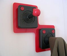 Joysticks + wall hooks = jacket pegs. I'd do my genkan (front entryway) all video game-themed just for these.