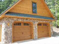 Clopay Gallery Collection garage doors look like wood but are constructed from stained steel for a low-maintenance garage door with loads of charm. The finish color matches the logs perfectly and brings out the warm tones in the stone. Installed by Central PA Dock and Door. www.clopaydoor.com
