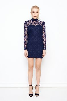 High neck lace dress with open back. Flower patterned lace in navy blue and lace covered buttons in neck. Beautiful lace ribbons in back and neck.