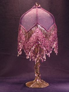 I love victorian style things, and I love the beads. Pretty victorian beed lamp.. bing.com