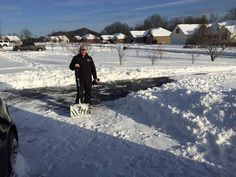 Eastern Kentucky University President Michael Benson is shown after shoveling a student's driveway in Kentucky.