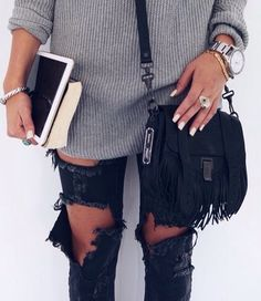 ripped jeans and fringe bag