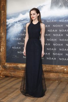 Emma Watson in Wes Gordon Watson looks all kinds of stunning. This navy and black tulle chiffon racerback gown makes the actress appear 10 f...