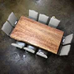 A growing trend of adding the natural element of a rustic table. The natural choice is reclaimed wood but live edge wood slabs are also a great option.