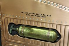 really amazing firewall and cowl on a hot rod that are covered with small riveted plates of what looks like brass. Pic 4