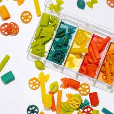 Dye pasta for a cost-effective sorting game for toddlers.
