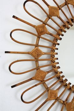 Unusual handcrafted rattan or wicker mirror with all the taste of Mediterranean coast style. This mirror was made with alternating curved and straight cane rays surrounding the glass, with wicker rhombus decorations at each straight ray, Spain, Wicker Couch, Wicker Trunk, Wicker Headboard, Wicker Mirror, Wicker Shelf, Wicker Bedroom, Wicker Table, Chair Cushions, Wicker Baskets