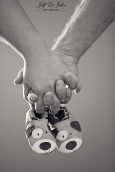Jeff & Julie Photography: maternity portrait of couple holding hands and doggie baby booties