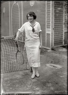 Actress, Grace Valentine, playing tennis 1920.   Sailor inspired tennis outfit.