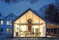 Floating Farmhouse with Curtain Wall Glass