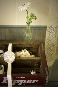 Corsage and boutonnieres in an antique Dr. Pepper crate. See more rustic wedding ideas at mythreeweddings.com