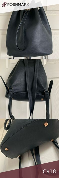 """H&M Black Drawstring Backpack Black faux-leather backpack with a drawstring tassel to close the bag. Adjustable straps with 9 holes for the buckle. 1 inside zipper pocket and 2 inside pouches. Has studs at the bottom so it protects the bag from scuff marks when on a hard surface.  100% polyester  Size: O/S Brand: H&M Length: 12.5"""" Width: 14"""" Inside depth: 6"""" x 10"""" H&M Bags Backpacks Faux Leather Backpack, Black Backpack, H&m Bags, Black Faux Leather, Pouches, Drawstring Backpack, Tassel, Studs, Surface"""