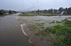 eptrail > A usually small creek overruns its banks and closes Carriage Drive on Thursday. The floodwaters made travel in Estes Park difficul...