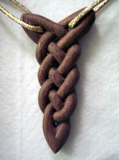 Hand carved knot [Definitely don't like the necklace; not sure about the knot. Other Celtic knots would be more desirable, I feel]