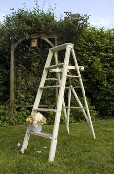 white ladder alter idea.  this web site (Maggpie) you can rent vintage things from for you wedding.
