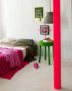 neon tape as wall art in a fresh, surprising, inspiring bedroom. Ultra modern