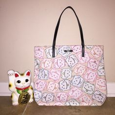 """kate spade lucky cat tonti street Bon shopper! kate spade lucky cat tonti street Bon shopper! BNWT! ❤️ hard to find! Item is unused in brand new condition with tags! So much cuter in person! 16"""" x 13"""" x 5"""" with 8"""" handle drop. No trades or PayPal!  kate spade Bags Totes"""