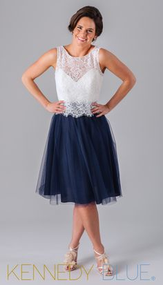 A stunning two-piece bridesmaid dress with a lace top and knee length tulle skirt.