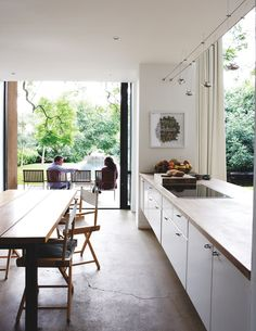Would love an open plan kitchen leading outdoors like this