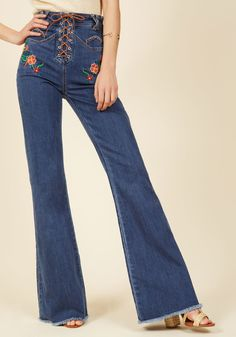 <p>If styles of the past capture your curiosity, then these bell bottoms from Somedays Lovin are sure to stimulate your sartorial interest! Amplifying this denim pair's high-waisted silhouette is a lace-up front, rich floral embroidery, and whip-stitched accents - all of which embody what intrigues you about retro fashion.</p>