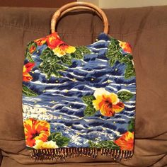 """Beachy boutique hobo with Bamboo handles Summer hang bag with bamboo handles and fringe detail. Gently used condition. Great for your next beach trip! Bag measures 13"""" x 12"""" without handle. Boutique Bags Hobos"""
