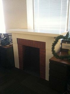 Faux holiday fireplace made from cardboard boxes and a few other inexpensive supplies.