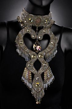 Sherry Serafini's gorgeous beadwork: That's simply stunning. I want to make some massive statement piece necklaces but I don't think mine will never be as stunning as this one.